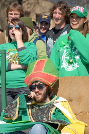 The 2008 St. Pat, Paul Voss, watches St. Pat's Follies last March along with a throng of S&T students. (How'd that guy with the Michigan cap get in there?)
