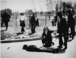 The iconic image: Mary Ann Vecchio kneeling by the body of a student lying face down on the campus of Kent State University, May 4, 1970. (AP photo/John Filo)
